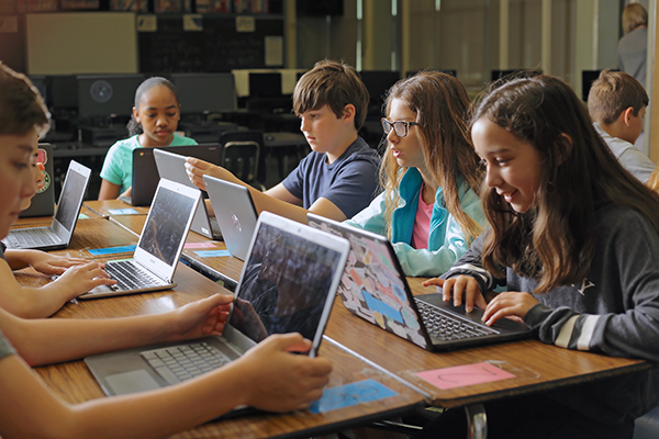 Students in using Chromebooks
