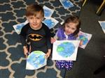 students with Earth drawings